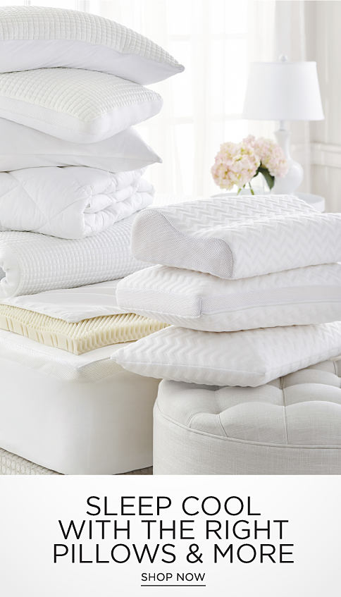 A stack of white pillows, mattress pads and comforters with cooling technology. Sleep cool with the right pillows and more. Shop now.