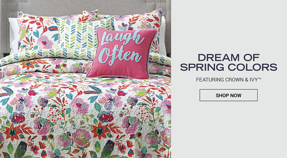 A colorful, floral comforter set with matching pillows and decorative pillows. Dream of spring colors. Featuring Crown & Ivy. Shop now.