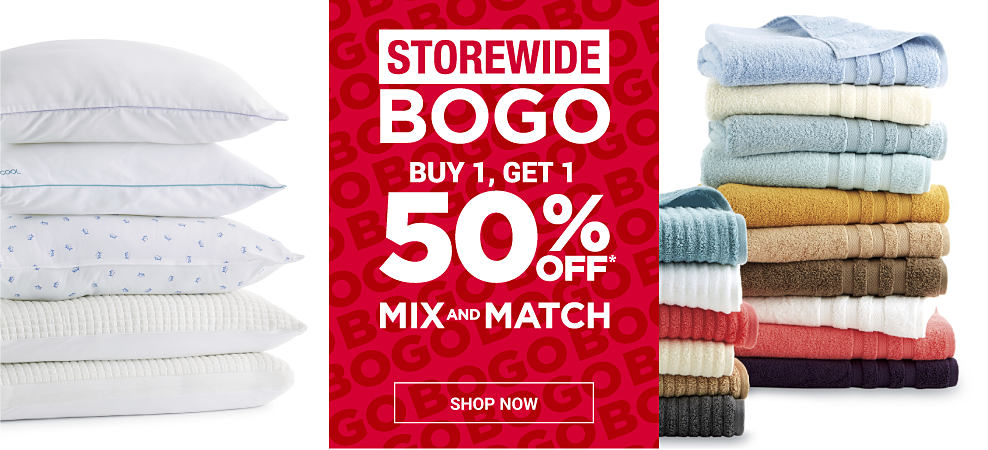 A stack of pillows with a variety of different features and styles and a stack of towels in a variety of different colors and styles. Storewide buy 1, get 1 50% off. Mix and match. Shop now.