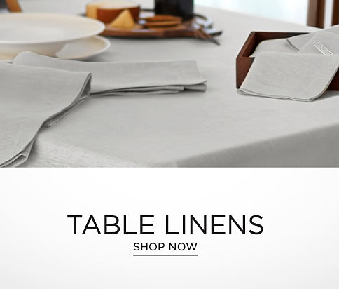 A table set with gray table linens. Table linens. Shop Now.
