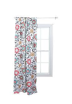 A floral curtain. Shop window treatments.