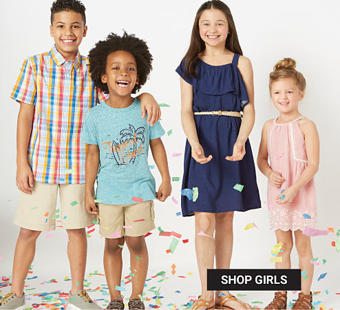 A boy wearing a white, red, blue & yellow plaid short sleeved button front shirt, beiege shorts & beige sneakers. A boy wearing a light blue T shirt with a multi colored front graphic, beige shorts & gray sneakers. A girl wearing a navy short sleeved dress & brown sandals. A girl wearing a light pink sleeveless dress & brown sandals. Bonus Buy. Up to 50% off True Craft. Exclusively at Belk. Shop girls.