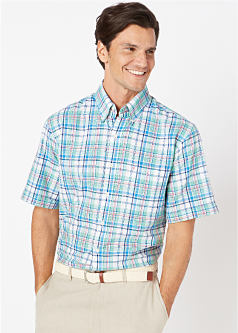 A man wearing a multi colored plaid short sleeved shirt & off white pants. Shop big & tall.