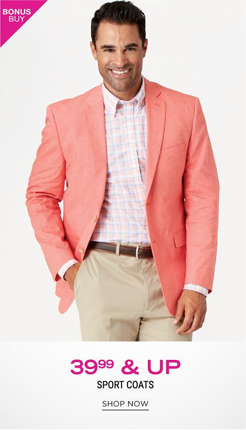A man wearing a salmon sport coat, a coral, blue & white plaid dress shirt & beige pants. Bonus Buy. $39.99 & up sport coats. Shop now.