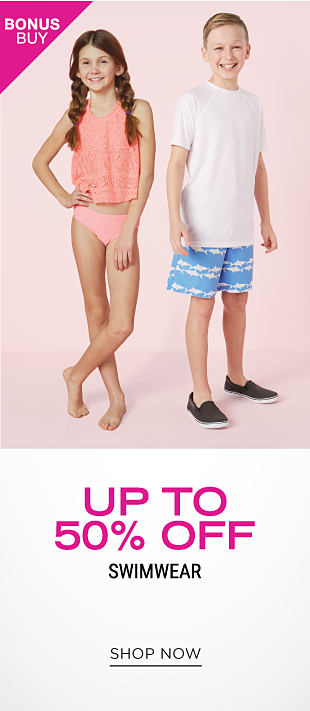 A girl wearing a salmon two piece swimsuit standing next to a boy wearing a white T shirt & light blue & white patterned print swim trunks & black sneakers. Bonus Buy. Up to 50% off swimwear. Shop now.