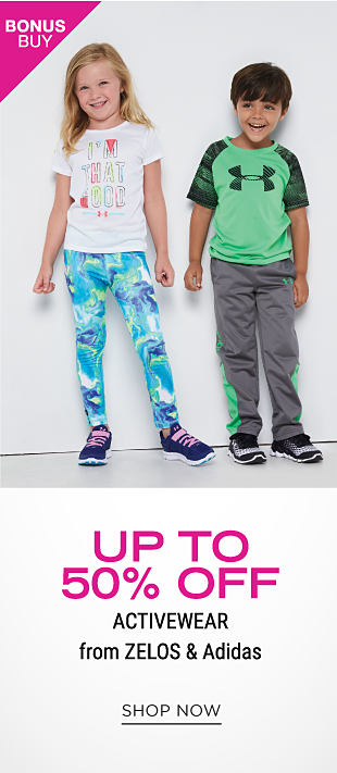 A girl wearing a mint green sleeveless tee with a multi colored front graphic, multi colored print shorts & black sneakers standing next to a boy wearing a gray, blue & red soccer themed graphic tee, navy shorts & navy sneakers. Bonus Buy. Up to 50% off activewear from Zelos & Adidas. Shop now.