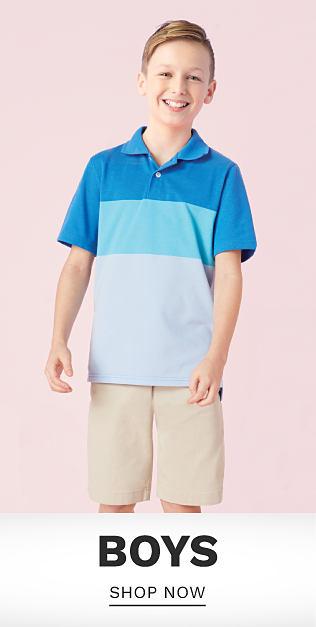A boy wearing a blue, teal & light blue polo & beige shorts. Shop