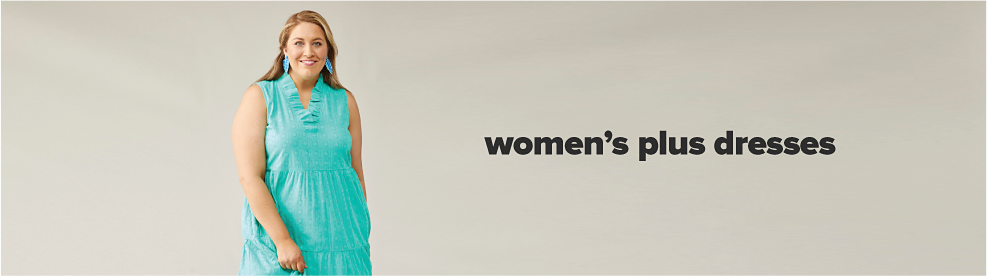 A woman in a teal dress with matching earrings. Women's plus dresses
