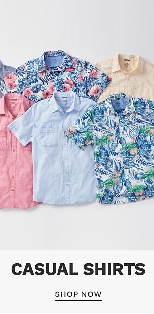 An assortment of men's short sleeved button front shirts in a variety of colors & prints. Casual Shirts. Shop now.