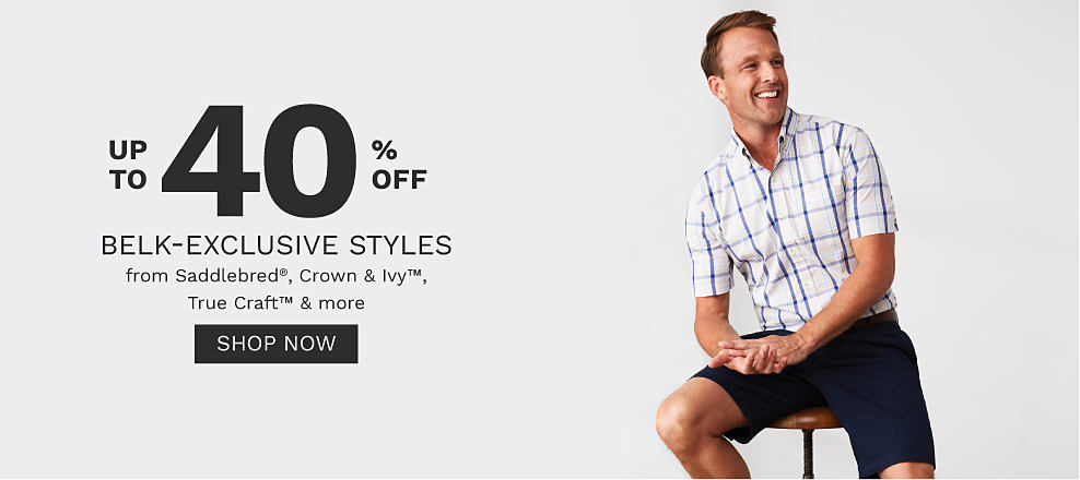 A man wearing a white & blue plsid short sleeved button front shirt & navy shorts. Up to 40% off Belk exclusive styles from Saddlebred, Crown & Ivy, True Craft & more. Shop now.