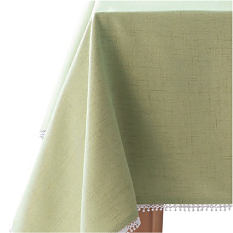 A table covered with an olive green table cloth. Table linens. Shop now.
