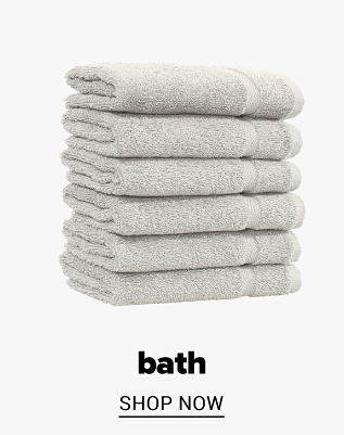 A stack of grey towels. Bath. Shop now.