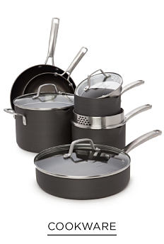 A set of gray non-stick pots and pans with glass lids. Shop cookware.