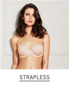 4a8adfd4a A woman wearing a beige strapless bra. Shop strapless.