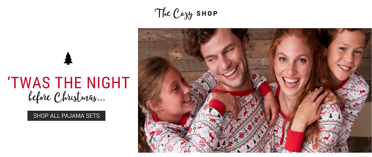 A man, woman, girl & boy wearing matching multi colored patterned print holiday pajamas. The Cozy Shop. Twas the night before Christmas. Shop all pajama sets. Shop women. Shop men. Shop girls. Shop boys.