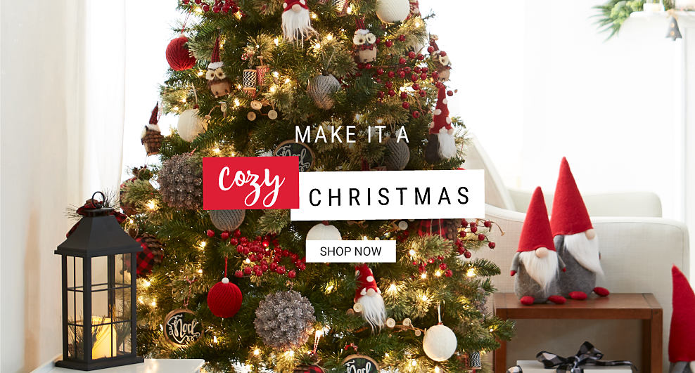A fully decorated Christmas tree surrounded by gnome figurines. Make It a Cozy Christmas Shop now.