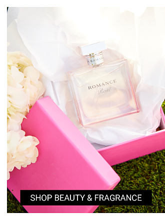 8c764ff27c7 An opened pink gift box with a bottle of women s fragrance inside. Shop  beauty