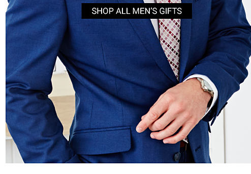 A man wearing a blue suit, a white dress shirt & a plaid tie. Grab something great that he'll love.