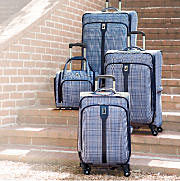 four piece luggage set on stone staircase