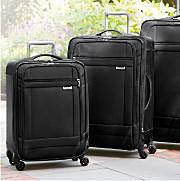 four black luggage spinners