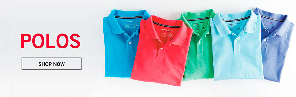 An assortment of folded men's polo shirts in a variety of colors. Polos. Shop now.