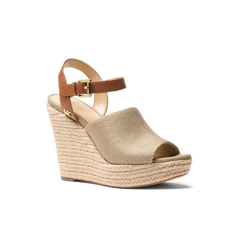 A beige strappy wedge. Shop shoes.