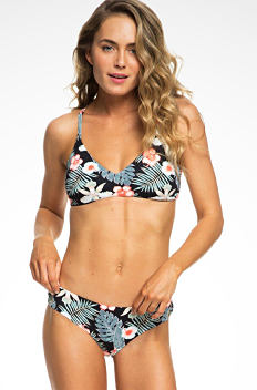 A young woman wearing a multi colored floral print bikini. Shop complete looks.