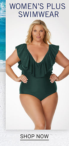 69b06f768c A woman wearing a dark green one piece swimsuit with frilled neckline  detail. Women's Plus