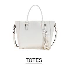 A white tote bag. Shop Totes