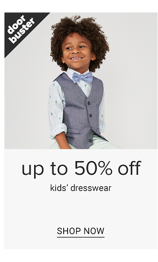 A boy wearing a dark gray vest over a white dress shirt, dark gray bow tie & white pants. Doorbuster. Up to 50% off kids dresswear. Shop now.