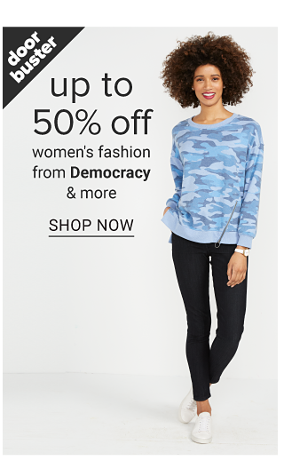 A woman wearing a light blue & white print long sleeved top, navy pants & white shoes. Doorbuster. Up to 50% off women's fashion from Democracy & more. Shop now.