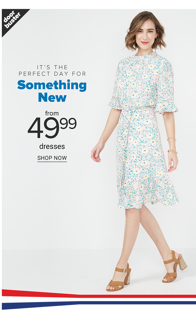 A woman wearing a multi colored floral print short sleeved dress. Doorbuster. It's the Perfect Day for Something New. From $49.99 dresses. Shop now.