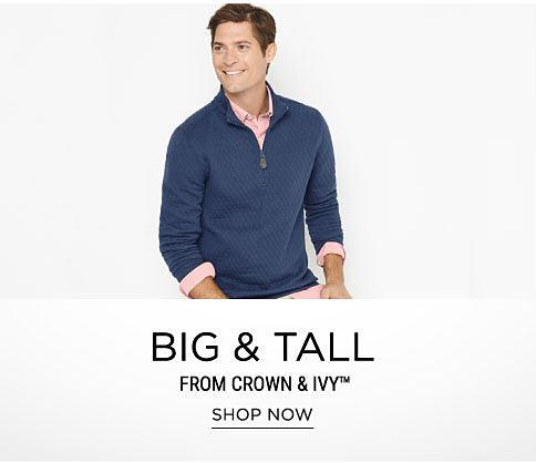 A man wearing a navy quarter zip fleece, a light pink long-sleeved button-front shirt & beige pants. Big & Tall from Crown & Ivy. Shop now.