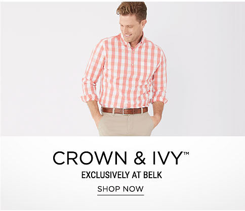 A man wearing a peach & white plaid long-sleeved button-front shirt & beige pants. Crown & Ivy. Exclusively at Belk. Shop now.