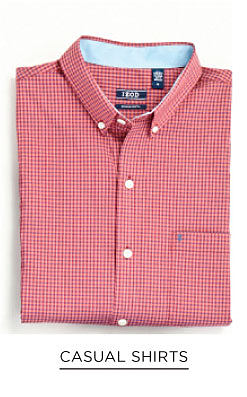 A folded red & white check long-sleeved button-front shirt. Casual shirts. Shop now.