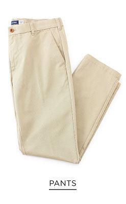 A folded pair of beige men's pants. Pants. Shop now.