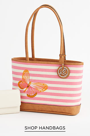 A white wallet next to a pink and white stripe tote with light brown top handles and bottom. It is accented by a butterfly design and finished with a silvertone Kim Rogers hanging tag. Shop Handbags.