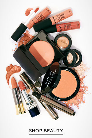 A variety of beauty products, from lipstick to eyeshadow, in pink and peach shades. Shop Beauty.