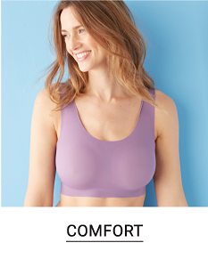 A woman in a purple wirefree bra. Shop comfort.