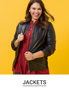 A woman in a red button front top and a black faux leather jacket. Shop jackets.
