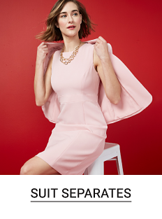 A woman in a light pink sleeveless dress and a light pink blazer over her shoulders. Shop suit separates.