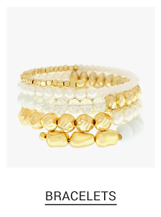 A gold tone & faux pearl bracelet. Shop fashion jewelry bracelets.