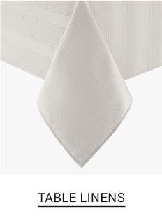 A white table cloth on a table. Shop table linens