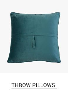 A dark teal throw pillow. Shop throw pillows.