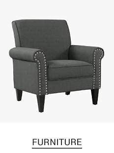 A dark brown armchair. Shop furniture.