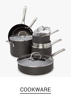 An assortment of gray non stick pots & pans with clear glass lids. Shop cookware.