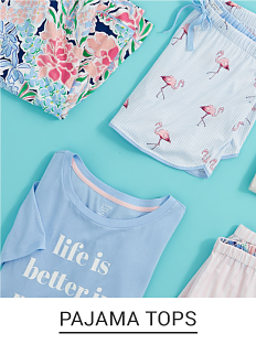 A light blue folded graphic tee, with a variety of printed shorts to match. Shop pajama tops.