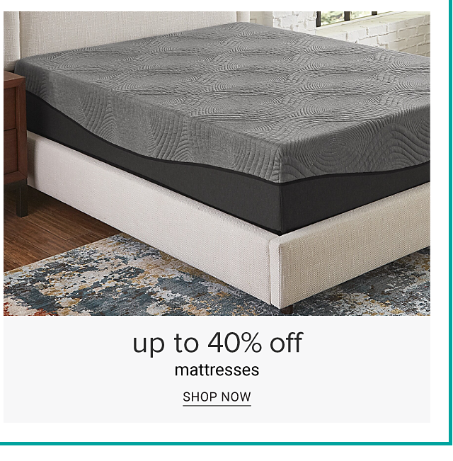 A gray & black colorblock mattress on top of a white box spring. Up to 40% off mattresses. Shop now.