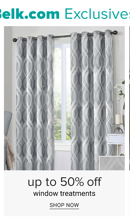 A window covered with gray & white patterned print curtains. Up to 50% off window treatments. Shop now.