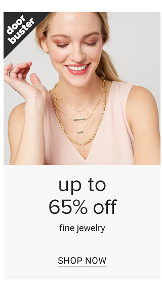 A woman wearing layered gold & diamond necklaces & a light pink sleeveless dress. Doorbuster. Up to 65% off fine jewelry. Shop now.